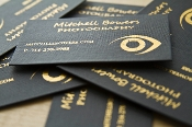 gold foil stamped on black cloth business cards
